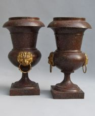 Pair of porphyry painted toleware Empire vases with gilded lion heads