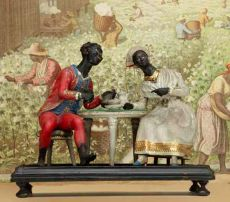 A RARE FRENCH COLONIAL SCULPTURE OF A COUPLE FROM THE FRENCH WEST INDIES, DRINKING RUM AND CHOCOLATE by Unknown Artist