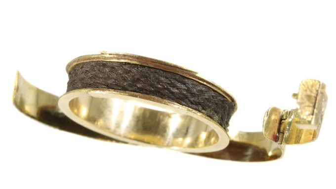 Gold antique ring with hidden space and woven hair by Unknown Artist