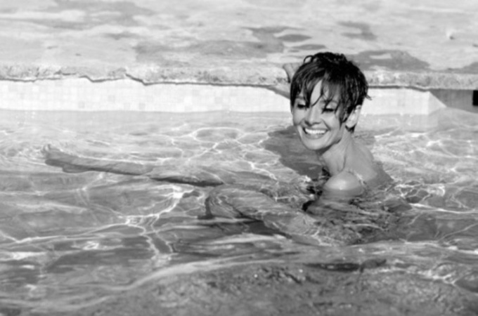 Audrey Hepburn in a pool in St Tropez. by Terry O'Neill