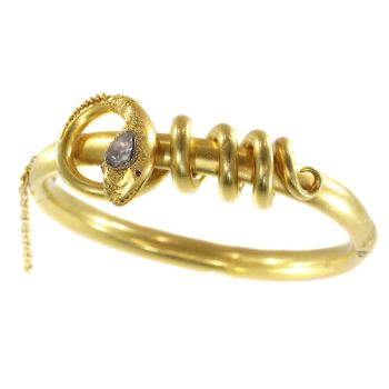 Antique Victorian 18K gold diamond bracelet snake coiled around its own body by Unknown Artist