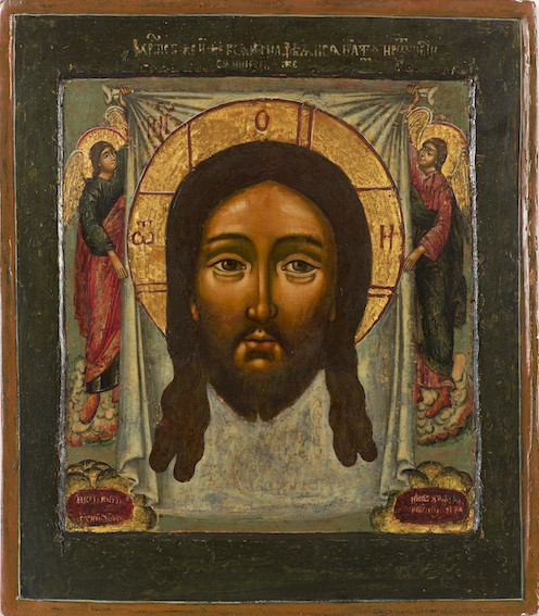 Russian wooden icon with silver rizza: The Holy Mandulion by Unknown Artist