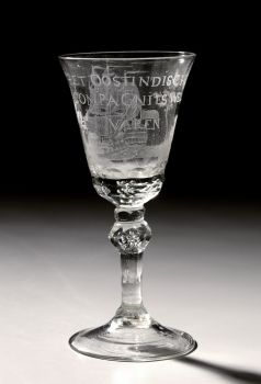 """A GLASS WITH THE ENGRAVING OF AN EAST-INDIAMAN AND WITH TEXT """"HET WEL VAAREN VAN DE OOSTINDISCHE COMPAGNIE"""" by Unknown Artist"""
