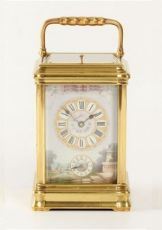 A French porcelain mounted gilt carriage clock,circa 1880 by Unknown Artist