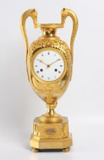 A French Empire ormolu urn mantel clock, circa 1800 by Unknown Artist