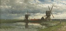 A polder landscape with windmills