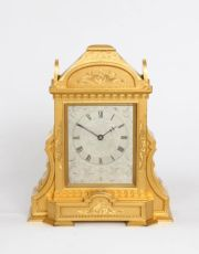An English gilt brass table clock in the manner of Thomas Cole, circa 1860 by Manoah Rhodes Bradford