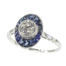 Vintage Art Deco platinum diamond sapphire engagement ring by Unknown Artist