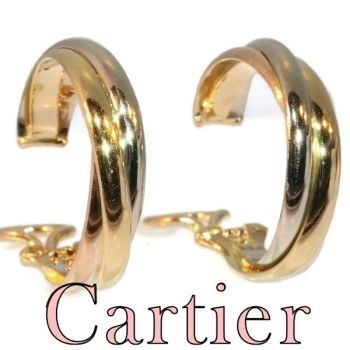 Vintage Signed Cartier ear clips model trinity three colours gold by Cartier .