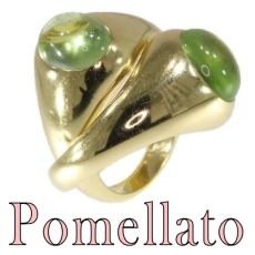 Original intertwined gold Pomellato rings with green garnets - demantoid by Unknown Artist