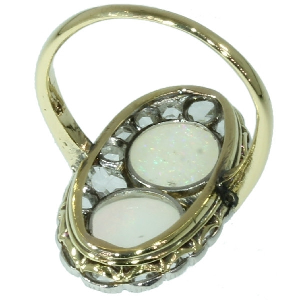 Antique Victorian engagement ring with rose cut diamonds and cabochon opals by Unknown Artist