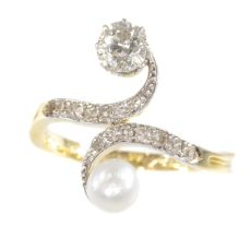 Elegant Belle Epoque diamond and pearl engagement ring so called toi et moi by Unknown