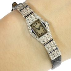 Art Deco platinum ladies wrist watch with diamonds and sapphires by Unknown Artist