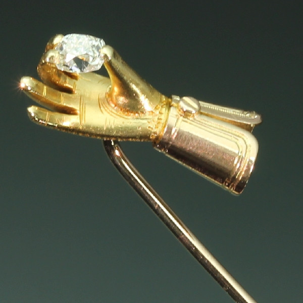 Antique Victorian tiepin gloved hand holding old cushion cut diamond by Unknown