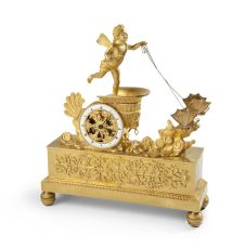 Empire Gilt Bronze Mantel clock with a winged putto by Unknown Artist