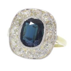 Vintage diamond and sapphire engagement ring by Unknown