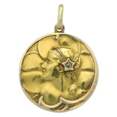Gold Art Nouveau pendant with rose cut diamond woman head on clover background by Unknown Artist