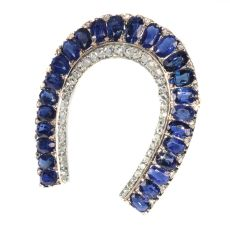 Antique Victorian brooch horse shoe with 67 diamonds and over 11 crts sapphires by Unknown Artist
