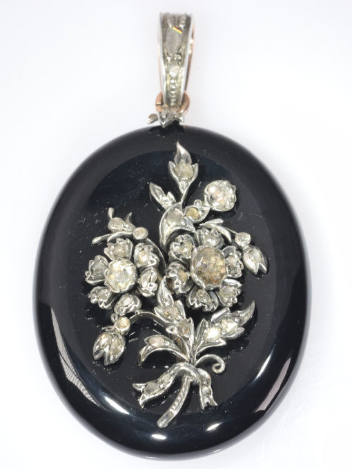 Antique Victorian onyx locket pendant with diamond loaded bouquet on top by Unknown Artist