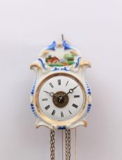 A small German polychrome striking and alarm wall clock, circa 1860 by Unknown Artist