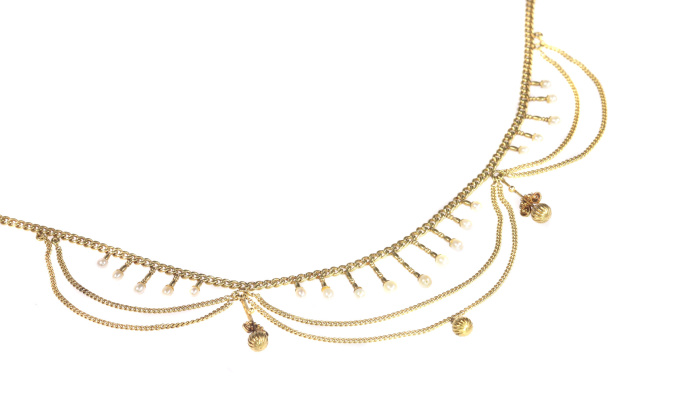Antique gold bow necklace with natural seed pearls by Unknown Artist