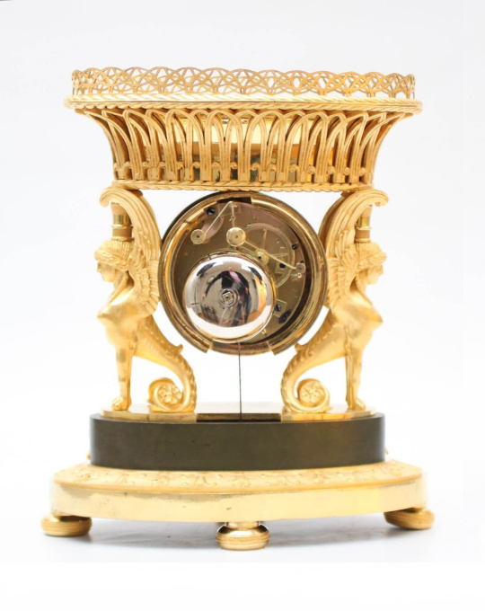 A French Empire ormolu urn mantel clock with griffins, circa 1800 by Unknown Artist