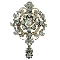 Antique Victorian diamond pendant and brooch loaded with old mine brilliant cuts by Unknown