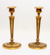 A pair French empire fire-gilt candlesticks, circa 1800 by Unknown Artist