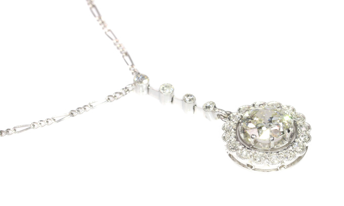 Platinum Art Deco diamond pendant on necklace by Unknown