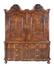 A Dutch double -dome cabinet