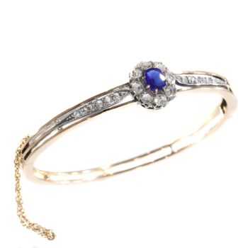 Antique Victorian gold bangle set with diamonds and blue strass by Unknown Artist