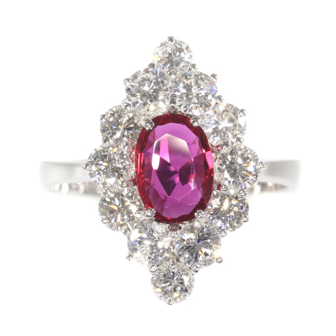 Vintage 1970's ring with beautiful ruby and set with 12 brilliant cut diamonds by Unknown
