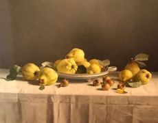 Still-life with quinces and hazelnut shells on a table