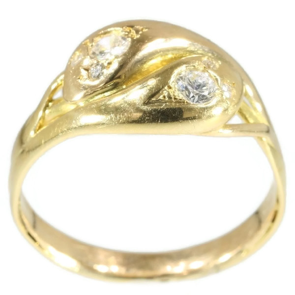 Antique double headed gold snake ring with diamonds by Unknown Artist