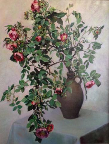 Jug on a table with branches of blooming rosa rugosa by Wouter Schram