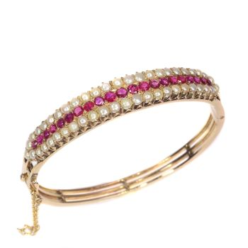 Vintage antique gold bangle with natural pearls and rubies sold by Simons Jewellers The Hague & Amsterdam by Unknown Artist
