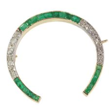 Vintage Art Deco horse shoe brooch set with diamonds and emeralds by Unknown