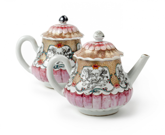 A pair of Chinese famille rose lotus-shaped teapots and covers by Unknown Artist
