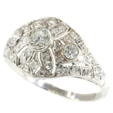 Platinum diamond engagement ring slightly domed by Unknown