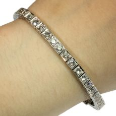 Estate platinum Art Deco diamond tennis bracelet from the fifties by Unknown Artist