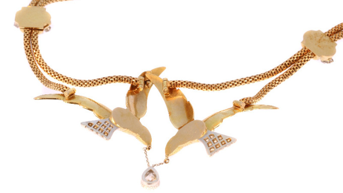 French Fifties necklace with two flying swallows carrying a pear shaped diamond by Unknown