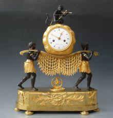 A fine and rare Empire 'Au Bon Savage' clock, 'The Stretcher Bearers' by Godeby à Paris, circa 1815.