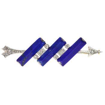 Diamond arrow brooch perforating three solid bars of lapis lazuli by Unknown Artist