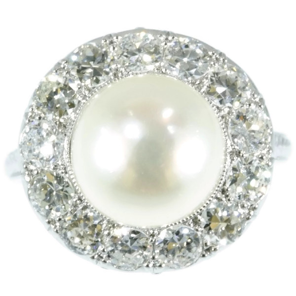 Diamond and pearl platinum estate engagement ring by Unknown Artist