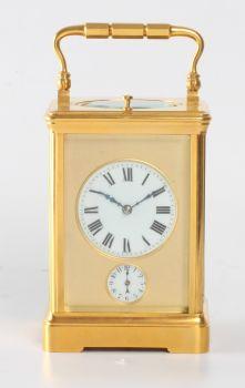 A French gilt brass quarter striking alarm carriage clock, circa 1890 by Unknown Artist