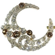 Antique brooch crescent moon with natural fancy color diamonds old cuts by Unknown Artist
