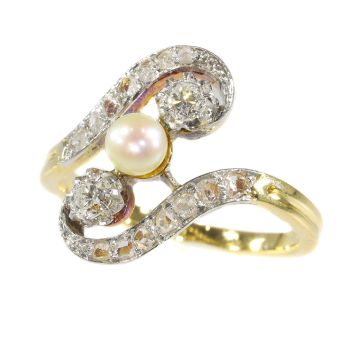 Antique diamond and pearl cross-over engagement ring by Unknown Artist