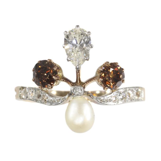 Belle Epoque diamond ring in Fleur-de-lis shape with fancy colour diamonds by Unknown Artist