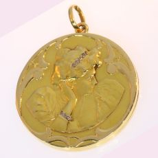 Late Victorian early Art Nouveau locket pendant, womans head with diamonds