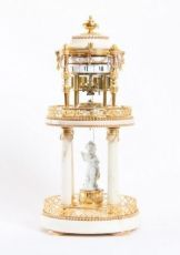 A French Louis XVI ormolu and marble cercles tournants mantel clock, Gille A Paris, circa 1775 by Gille A Paris